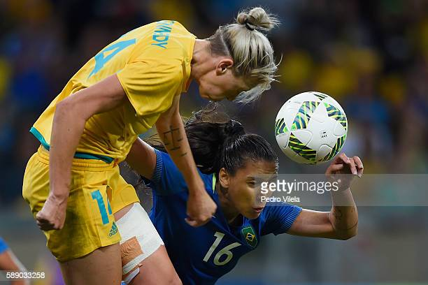Alanna Kennedy of Australia battles for the ball against Beatriz of Brazil during the second half of the Women's Football Quarterfinal match at...