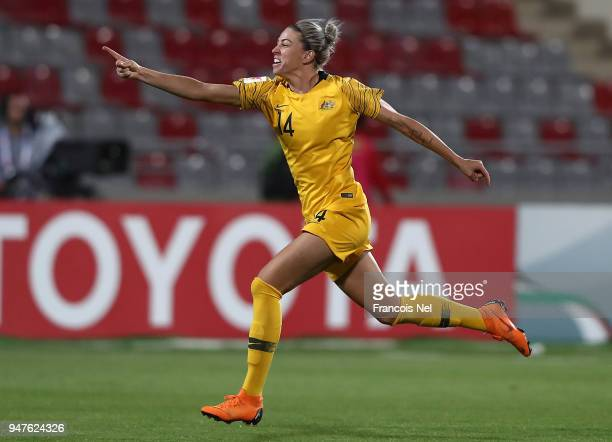 Alanna Kennedy of Australia celebrates winning the AFC Women's Asian Cup semi final between Australia and Thailand after a penalty shoot out at the...
