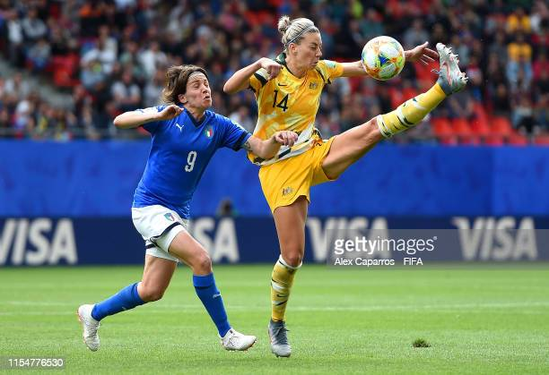 Alanna Kennedy of Australia controls the ball as she is put under pressure by Daniela Sabatino of Italy during the 2019 FIFA Women's World Cup France...