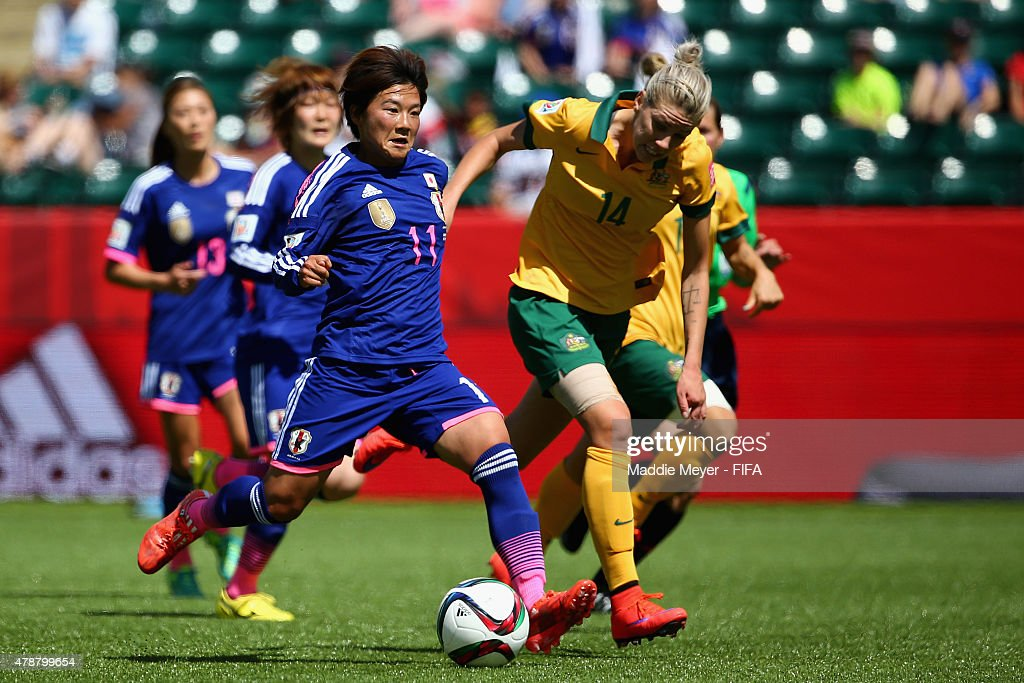 Alanna Kennedy #14 of Australia defends Shinobu Ohno #11 of Japan during the FIFA Women's World Cup Canada 2015 quarter final match between Japan and Australia at Commonwealth Stadium on June 27, 2015 in Edmonton, Alberta, Canada.
