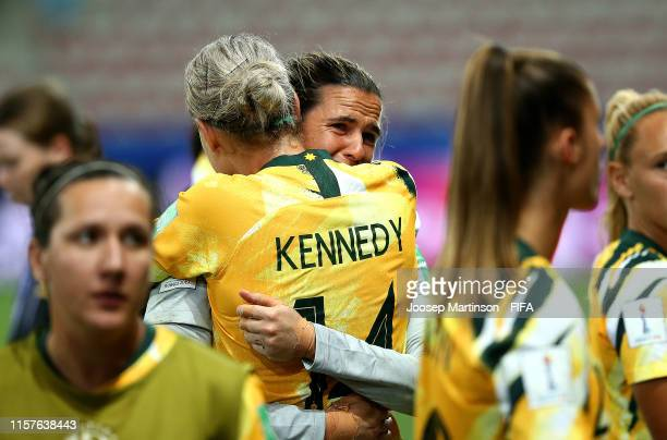 Alanna Kennedy of Australia hugs Lydia Williams of Australia after losing a penalty shoot after the 2019 FIFA Women's World Cup France Round Of 16...