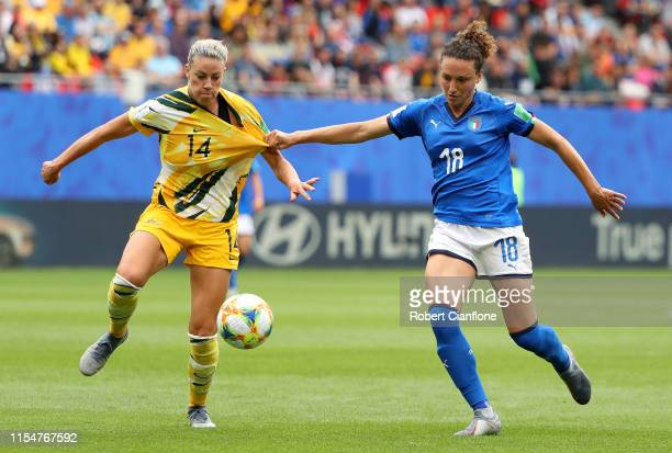 Alanna Kennedy of Australia is held by Ilaria Mauro of Italy during the 2019 FIFA Women's World Cup France group C match between Australia and Italy...