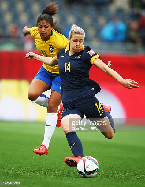 Alanna Kennedy of Australia takes on Cristiane of Brazil during the FIFA Women's World Cup 2015 round of 16 match between Brazil and Australia at...