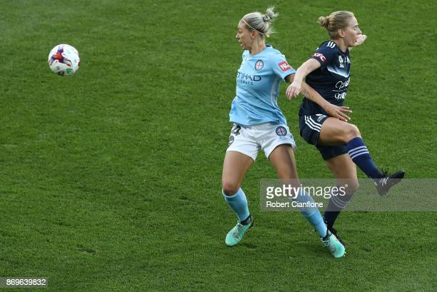 Alanna Kennedy of Melbourne City and Natasha Dowie of the Victory compete for the ball during the round two WLeague match between Melbourne City FC...