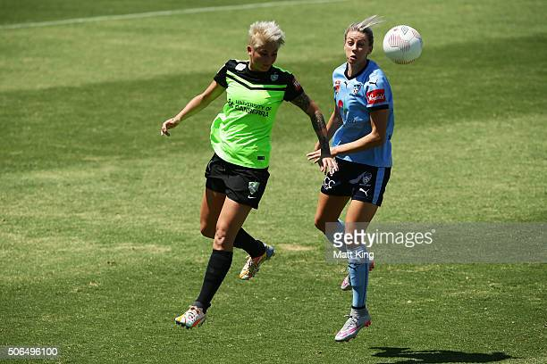 Alanna Kennedy of Sydney FC competes for the ball against Michelle Heyman of Canberra United during the WLeague semi final match between Canberra...