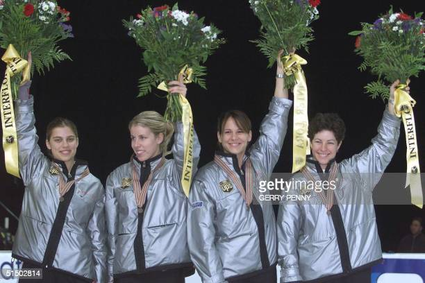 Alanna Kraus Annie Perreault Isabelle Charest and Tania Vincent of Canada present their silver medals 12 March 2000 after the women's 3000m relay...