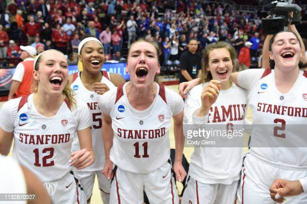 Alanna Smith of the Stanford Cardinal and teammates including from left Lexie Hull Maya Dodson and Shannon Coffee celebrate beating the BYU Cougars...