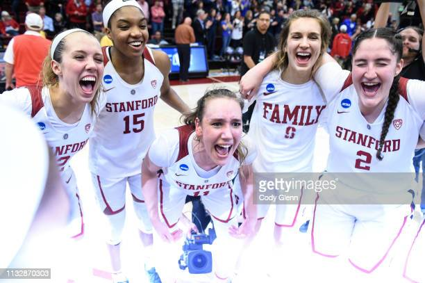 Alanna Smith of the Stanford Cardinal, center, and teammates including, from left, Lexie Hull, Maya Dodson and Shannon Coffee celebrate beating the...