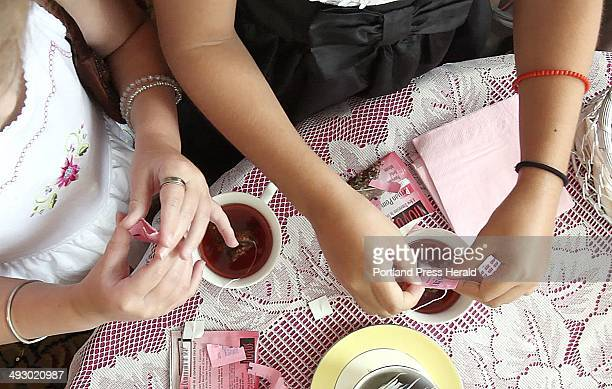 Alannah Shevenell left and her friend Laura Libby put sugar in their tea during a tea party for Shevenell and her friends at The Regency Hotel in...