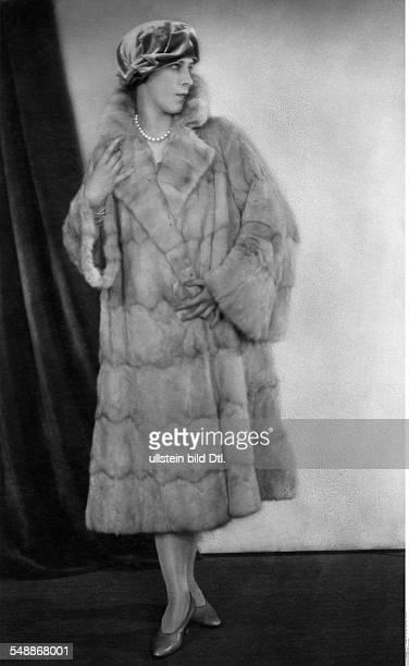 Alanova Alicia Dancer Russia fullfigure portrait in a mink fur coat with a velvet cap 1925 Photographer Atelier Balasz Published by 'Die Dame'...