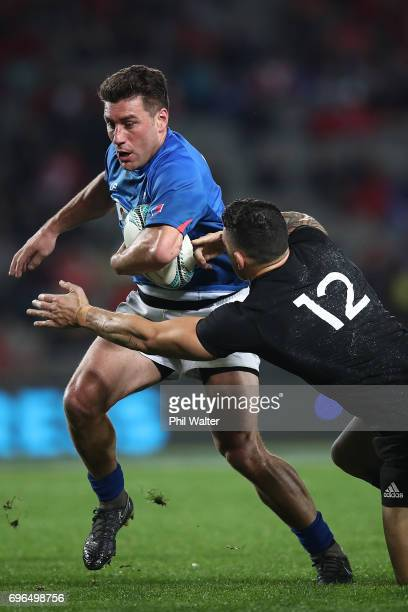 Alapati Leiua of Samoa is tackled by Sonny Bill Williams of the All Blacks during the International Test match between the New Zealand All Blacks and...
