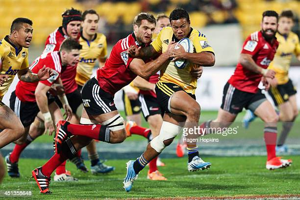 Alapati Leiua of the Hurricanes is tackled by Luke Whitelock of the Crusaders during the round 17 Super Rugby match between the Hurricanes and the...