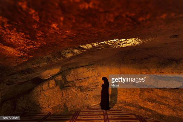 2008 AlAqsa Mosque Dome of the Rock Temple Mount Jerusalem Jerusalem district Palestine Israel A woman is praying in an underground prayer room of...