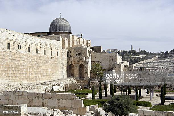 Al-Aqsa Mosque with itís grey dome and minaret. On the left is the southern wall of the Temple Mount and on the right the slopes of Mount of Olives. Jerusalem, Israel. This is where Mohamedís ride from Mecca to Jerusalem ended.