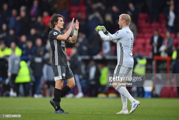 Çağlar Söyüncü of Leicester City and Kasper Schmeichel of Leicester City celebrate at the final whistle during the Premier League match between...