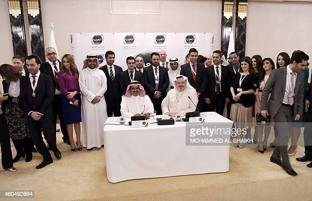 Alarab's general manager Jamal Khashoggi chairman of the board and chief executive officer of Alarab TV Fahad alSukait and members of the Alarab TV...