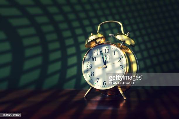 alarm clock at almost 12 o'clock - midnight stock pictures, royalty-free photos & images