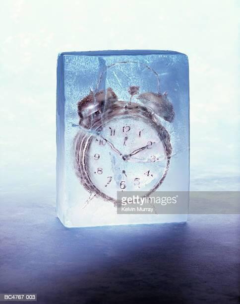 Alarm clock frozen in block of ice (Digital Composite)