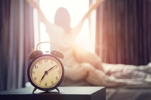 alarm clock having a good day in morning. 624545084