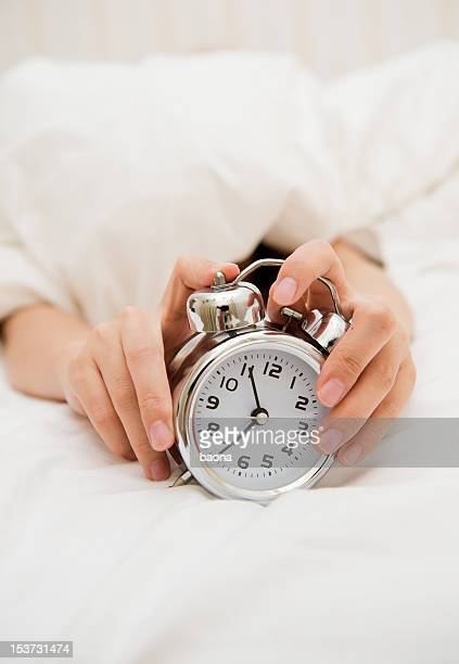 alarm clock in hand