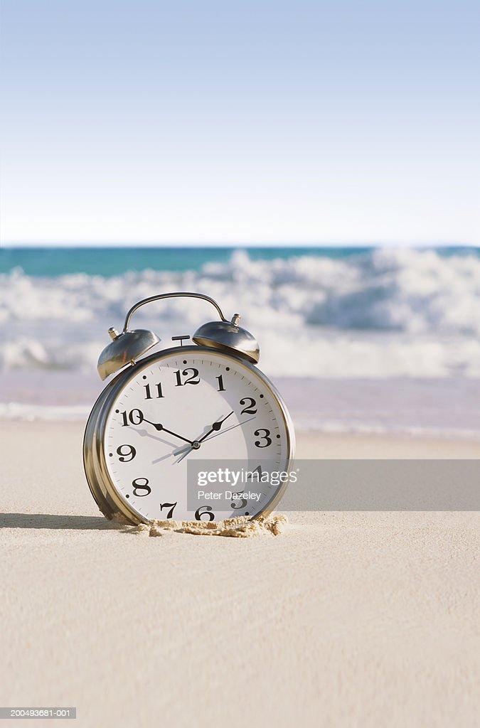 Alarm Clock On Beach Close Up Stock Photo