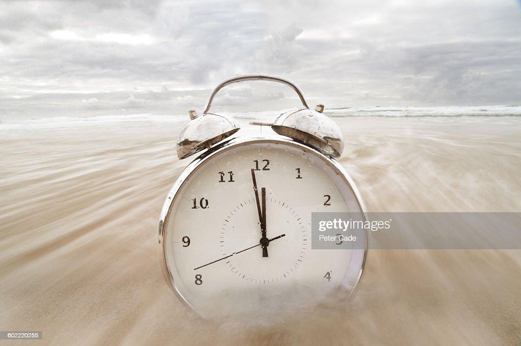 Alarm Clock On Beach In Sea Stock Photo