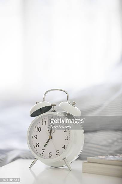 Alarm clock on bedside table
