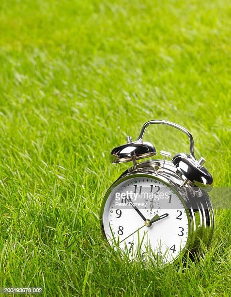 Alarm clock on grass, close-up