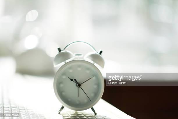 Alarm clock on kitchen counter