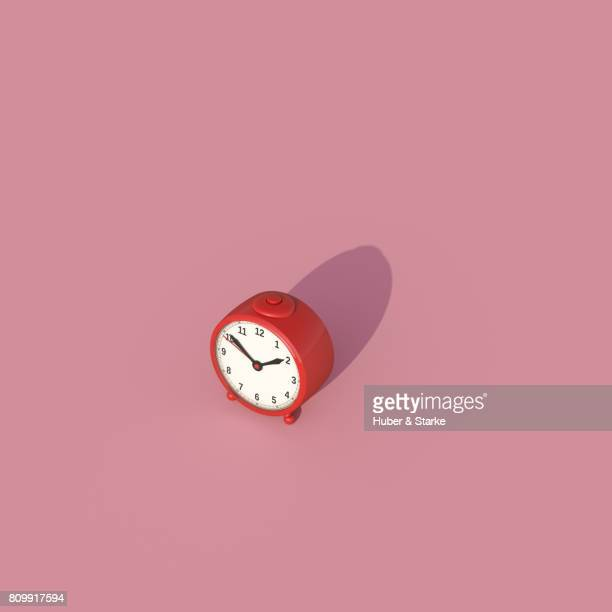 alarm clock on pink background