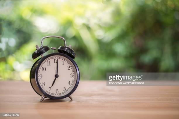 Alarm clock on table. Time management concept