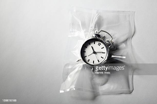 Alarm clock shrink wrapped in plastic