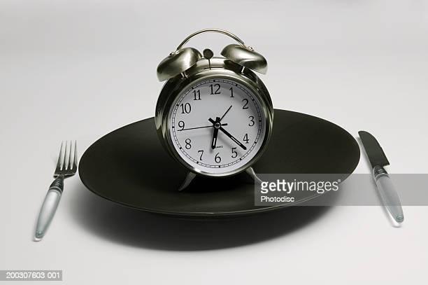 Alarm clock standing on black plate