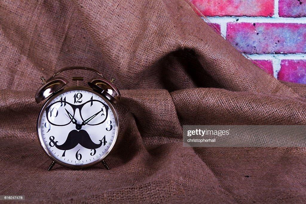 Alarm clock with a black hipster mustache : Foto de stock