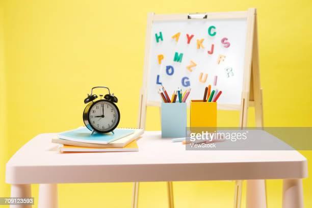 Alarm clock with stationery