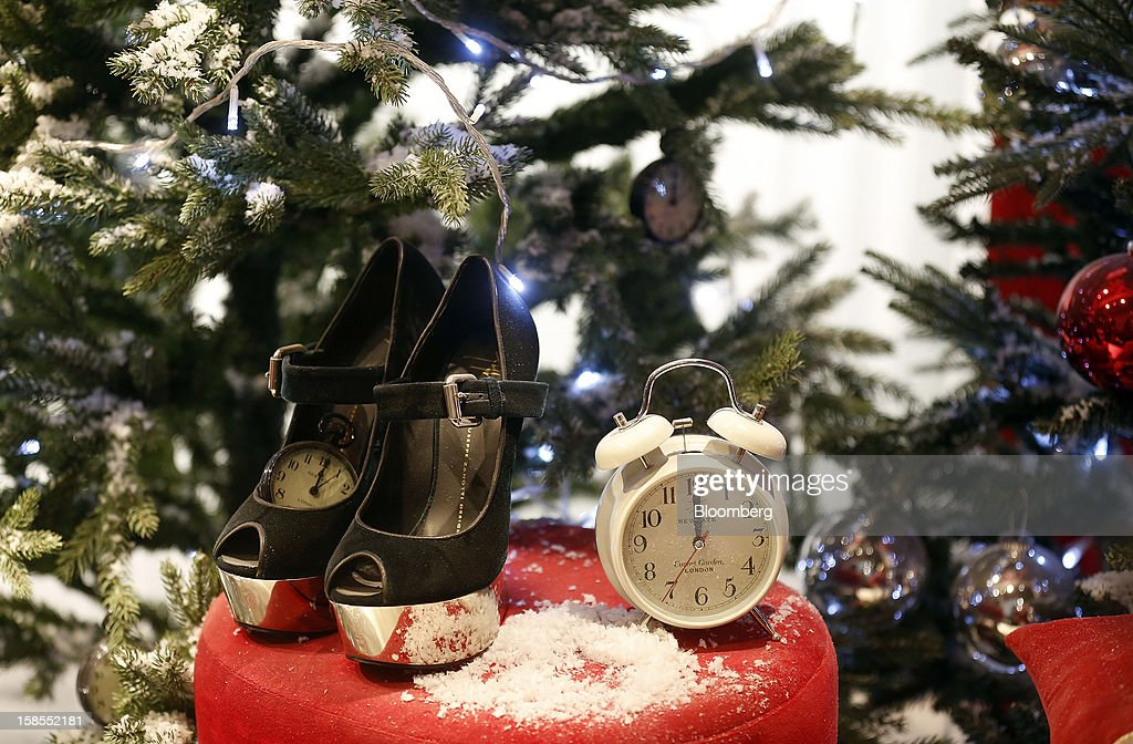 Alarm clocks and women's shoes sit in the Christmas window display of the Selfridges department store, operated by Selfridges Plc, on Oxford Street in London, U.K., on Monday, Dec. 17, 2012. Retailers are relying on Christmas sales to help rescue a year when high unemployment and the debt crisis have blighted spending. Photographer: Simon Dawson/Bloomberg via Getty Images