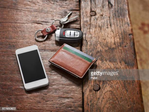 alarm device with cell phone and wallet on night table. - wallet stock pictures, royalty-free photos & images