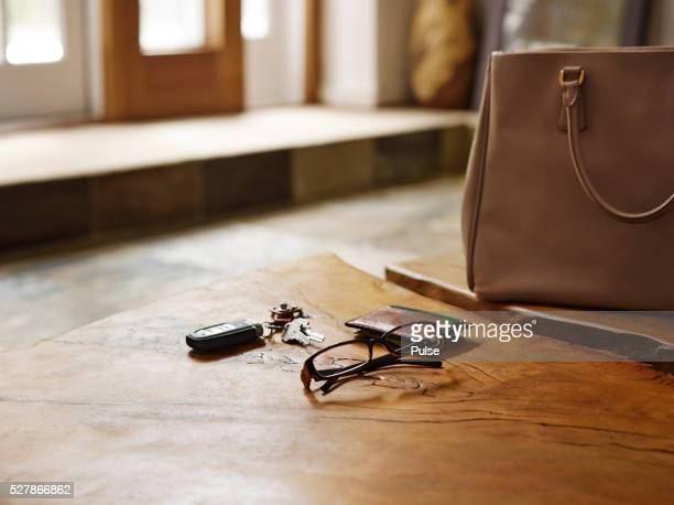 Alarm device with glasses and wallet on table