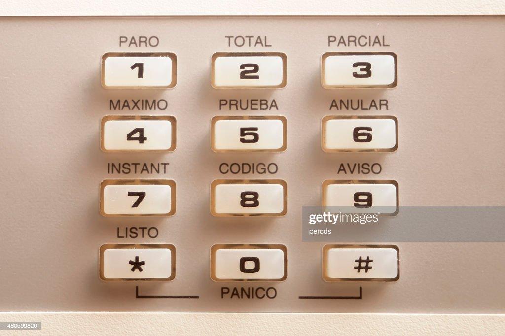 Alarm old-fashined keyboard in spanish language. : Stock Photo