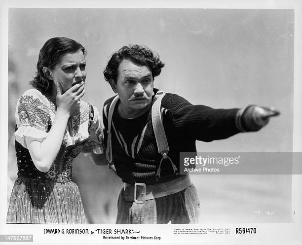 Alarmed Zita Johann is shown by Edward G Robinson where to look in a scene from the film 'Tiger Shark' 1932