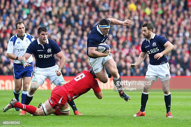 Alasdair Dickinson of Scotland is tackled by Dan Lydiate of Wales during the RBS Six Nations match between Scotland and Wales at Murrayfield Stadium...