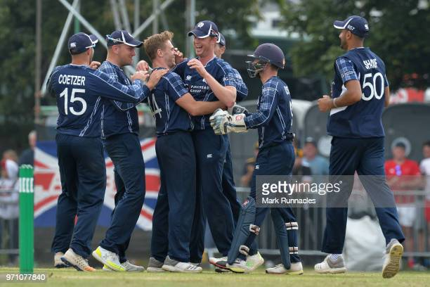 Alasdair Evans and Richie Berrington of Scotland celebrate taking the wicket of Alex Hales with there team mates during the One Day International...