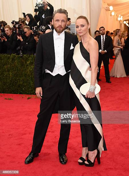Alasdhair Willis and designer Stella McCartney attend the 'Charles James Beyond Fashion' Costume Institute Gala at the Metropolitan Museum of Art on...