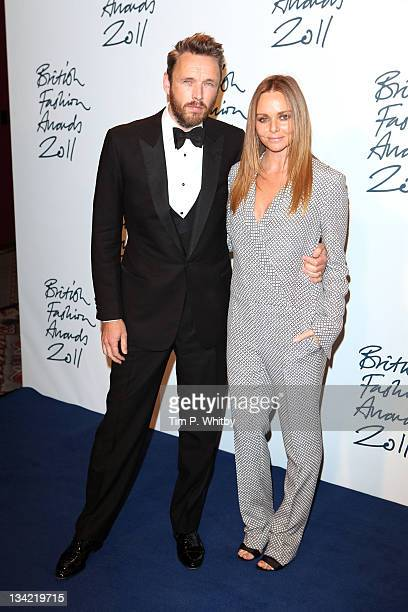 Alasdhair Willis and Stella McCartney arrive at the British Fashion Awards at The Savoy Hotel on November 28 2011 in London England