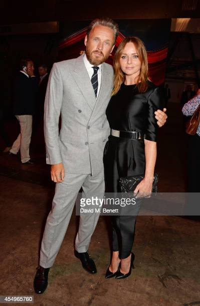 Alasdhair Willis and Stella McCartney attend as guests of Jaguar at the global reveal of the new XE in London at Earls Court on September 8 2014 in...