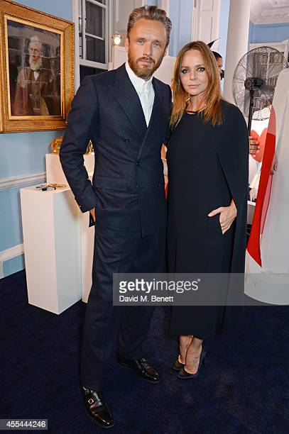 Alasdhair Willis and Stella McCartney attend The London 2014 Stella McCartney Green Carpet Collection during London Fashion Week at The Royal British...