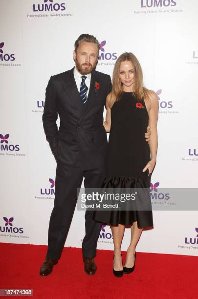 Alasdhair Willis and Stella McCartney attend the Lumos fundraising event hosted by JK Rowling at The Warner Bros Harry Potter Tour on November 9 2013...