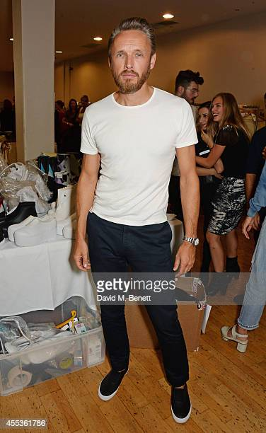 Alasdhair Willis Creative Director of Hunter attends the Hunter Original SS 2015 catwalk show at on September 13 2014 in London England