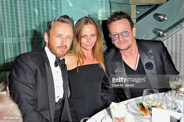 Alasdhair Willis Stella McCartney and Bono attend the GQ Men Of The Year Awards 2012 at The Royal Opera House on September 4 2012 in London England