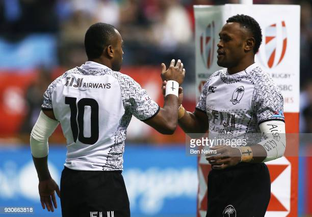 Alasio Sovita Naduva and teammate Amenoni Nasilasila of Fiji celebrate scoring a try against Kenya during the gold medal game at Canada Sevens the...